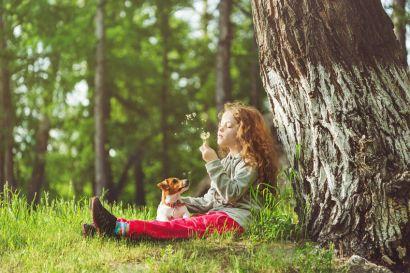 girl sitting under tree